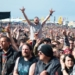CASTLE DONINGTON, ENGLAND - JUNE 15:  Festival goers cheering in the crowd during day 2 of Download Festival 2019 at Donington Park on June 14, 2019 in Castle Donington, England.  (Photo by Joseph Okpako/WireImage)